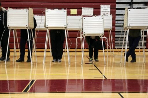 636650414252894152 Voting booth peoples legs