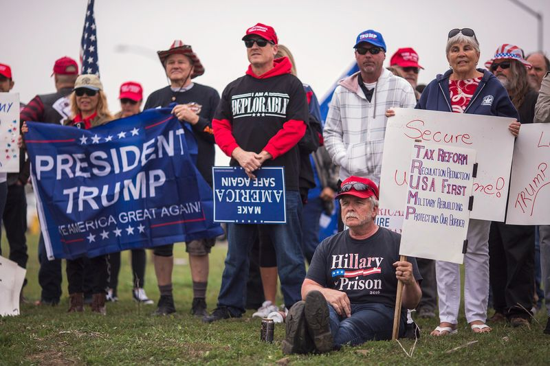 Pro-Trump activists hold a rally supporting President Trump's immigration policies.